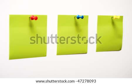 green empty notes and pins isolated