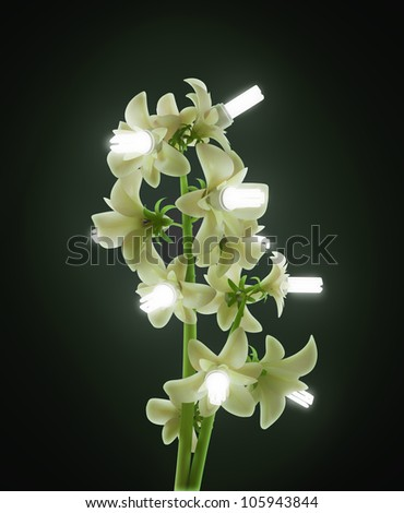 Green energy concept - a plant with energy saving bulb flowers - stock photo