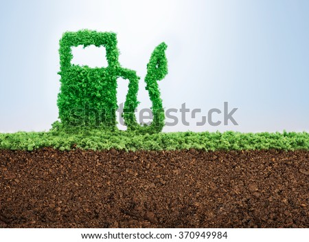 Green energy concept with grass growing in shape of fuel pump  - stock photo