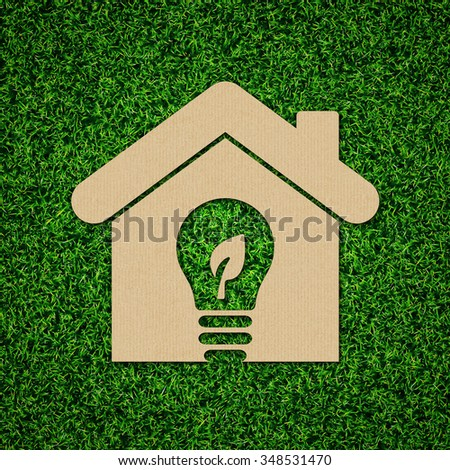 Green Energy Iconic Symbols on Green Grass. - stock photo