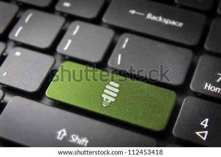 Green energy key with eco bulb light icon on laptop keyboard. Included clipping path, so you can easily edit it. - stock photo