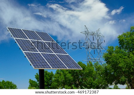 Green Energy Solar Panel on a Sunny Day with High Voltage Tension Power Lines