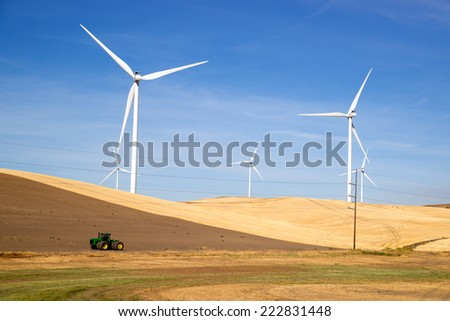 Green Energy Wind Turbines Rolling Agriculture Farmland - stock photo