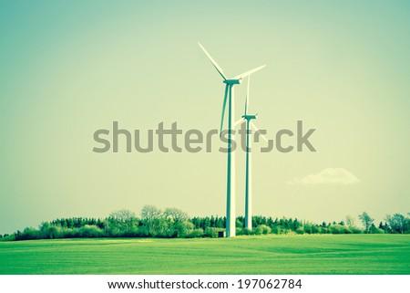 Green energy windmills in beautiful landscape - stock photo