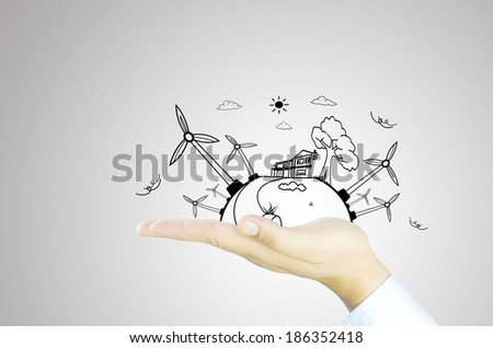 green energy world on hand - stock photo