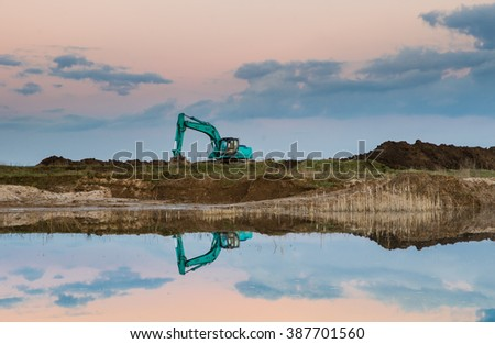 green excavator after work - stock photo