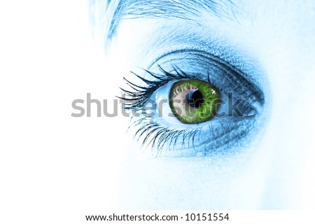 Green eye and blue tone face close-up. Shallow DOF. - stock photo