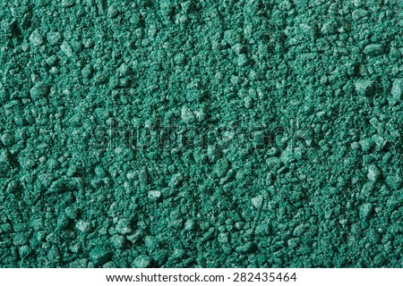 Green eye shadow crushed, make up powder texture background - stock photo
