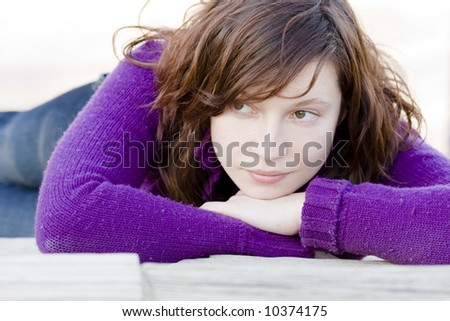 Green eyed sad young woman portrait - stock photo