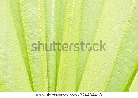 Green fabric curtain texture. - stock photo