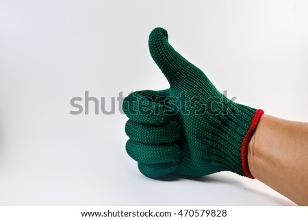 green fabric gloves. hand symbol
