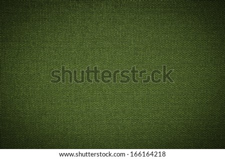 green fabric texture. coarse canvas background - closeup pattern