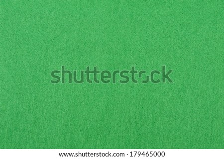 Green felt background. Useful for poker table or pool table surface - stock photo