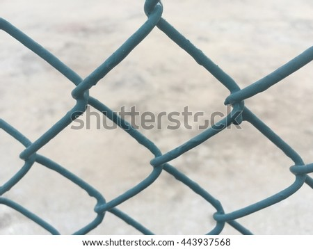 green fence chain on concrete floor background - stock photo