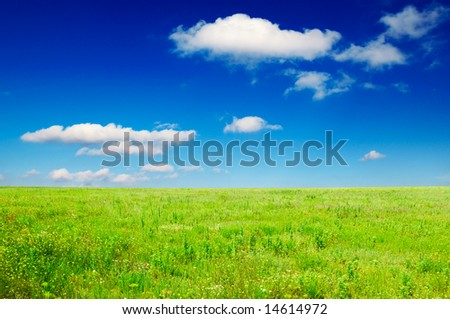 green field and beautiful clouds
