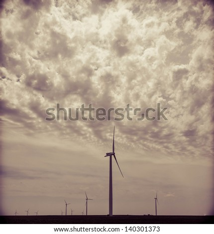Green field and clean energy concept. Wind Generators, Ecology. Wind generators generating green energy.