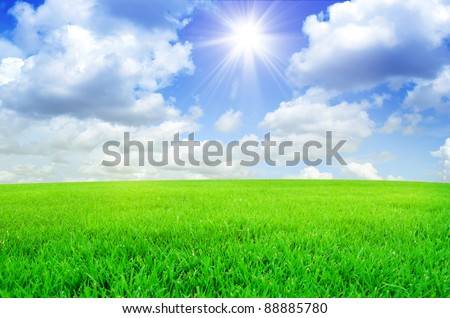 green field and clouds - stock photo