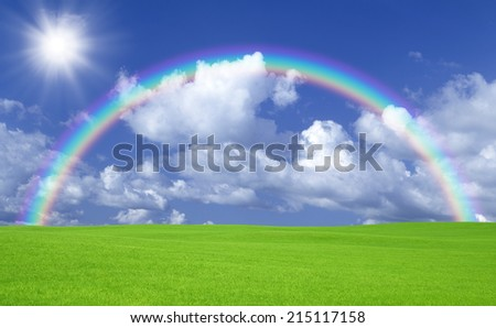 Green field and rainbow - stock photo