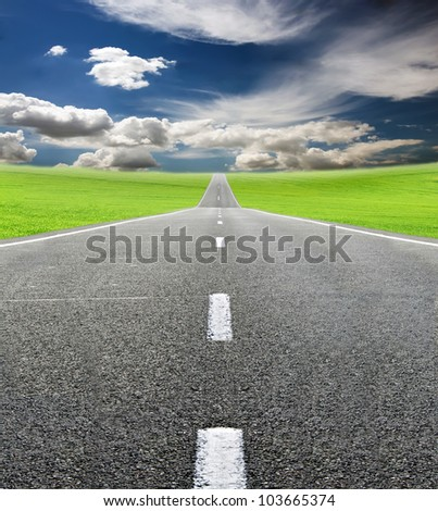 green field and road over blue sky - travel and tranportation concept - stock photo