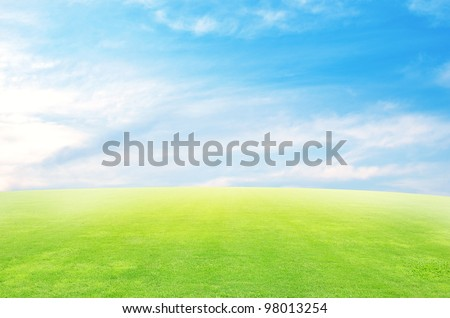 Green field and sky blue  with white cloud background - stock photo