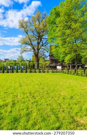 Green field in Lipnica Murowana village on sunny spring day, Poland - stock photo