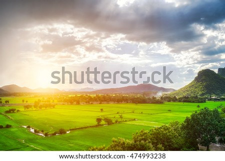 Green field mountain sunlight effect in countryside
