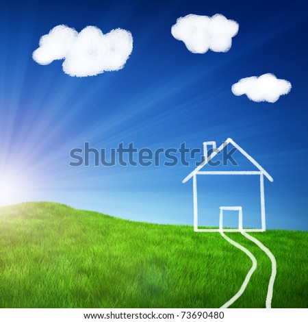 Green field with a chalk drawing of a house - stock photo
