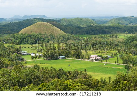 Green field with trees and hills view from above on Bohol island in Philippines - stock photo