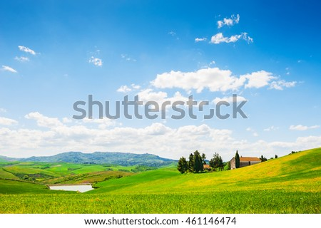 Green fields and blue sky. Beautiful summer landscape, Italy
