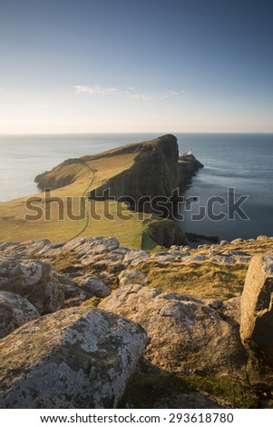 green fields and cliffs at sunrise on the isle of skye, scotland - stock photo