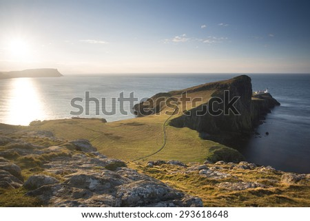 green fields and cliffs on the isle of skye, scotland - stock photo