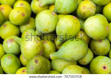 Green figs lay on the counter of street food market on Madeira island, Portugal. Close up photo with selective focus