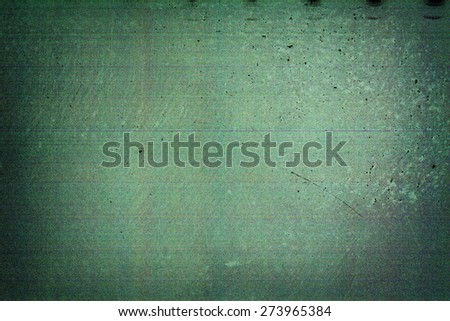 Green filmstrip texture background with heavy grain and dust - stock photo