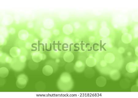 Green filtered bokeh abstract background.