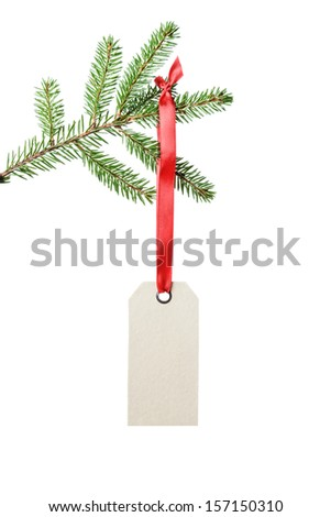 green fir branch with tag hanging on ribbon, isolated on white - stock photo