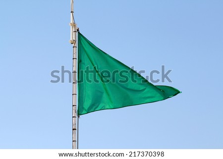 Green flag - Supervised swimming - stock photo