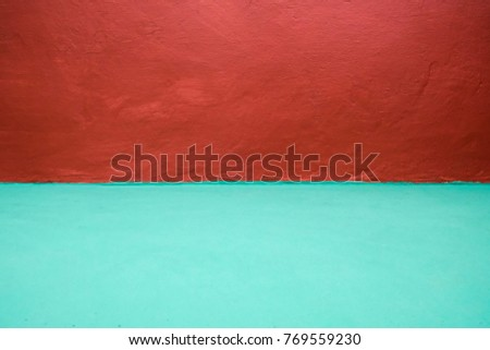 green floor and red wall background