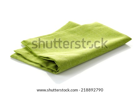 green folded cotton napkin isolated on a white background - stock photo