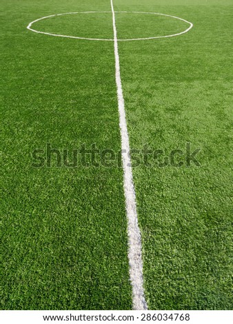 Green football Soccer field with artificial grass marking - stock photo