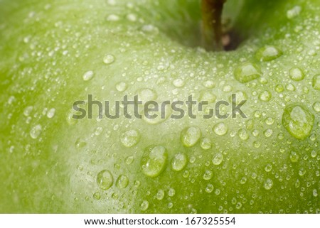 Green fresh apple with water drops - stock photo