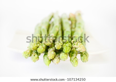 green fresh asparagus on white background - stock photo