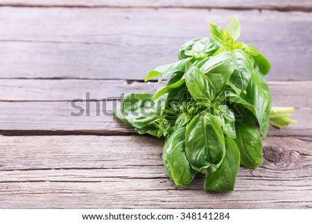 Green fresh basil on wooden background - stock photo