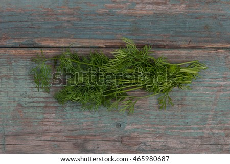 Green, fresh dill on wooden table, stock picture