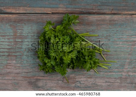 Green, fresh parsley on a wooden table, stock picture