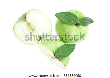 green fresh ripe apple with half isolated on white background - stock photo