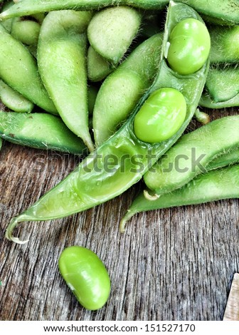Green fresh soybeans on wood background - stock photo