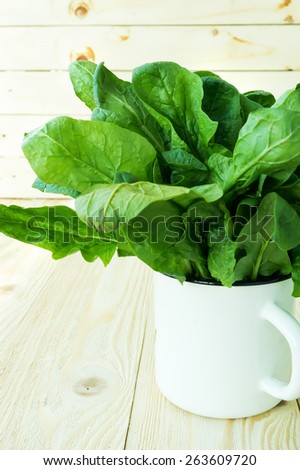 Green fresh spinach on a wooden table, selective focus