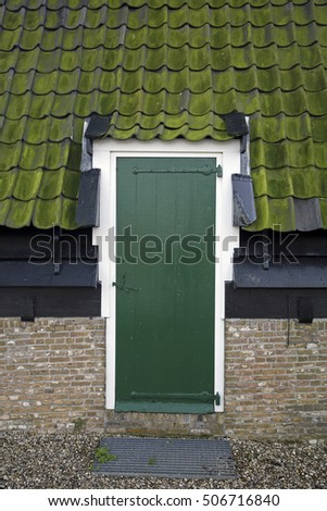 Green front door of windmill,  Unesco World Heritage Site Kinderdijk, Netherlands