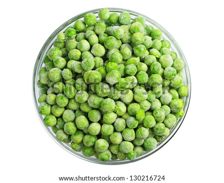 Green frozen peas in a glass bowl isolated on white. Top view - stock photo