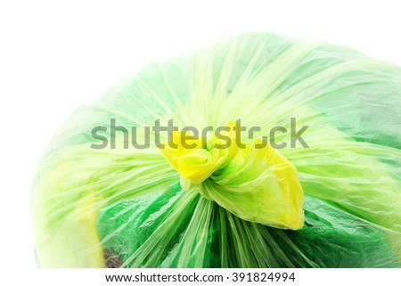 Green garbage bag closeup on white - stock photo